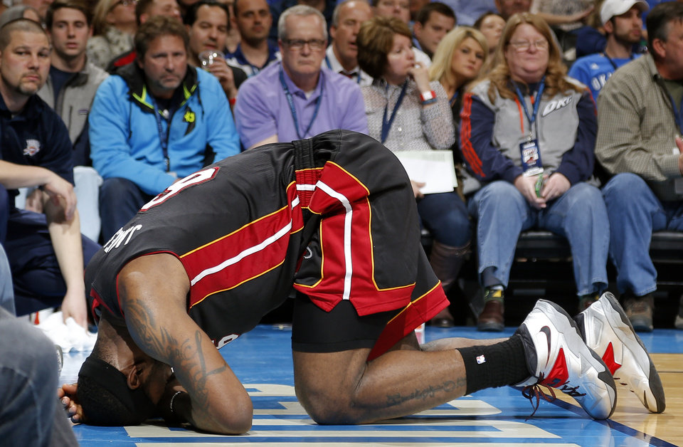 Miami's LeBron James (6) holds his head after an injury during an NBA basketball game between the Oklahoma City Thunder and the Miami Heat at Chesapeake Energy Arena in Oklahoma City, Thursday, Feb. 20, 2014. Oklahoma CIty lost 103-81. Photo by Bryan Terry, The Oklahoman