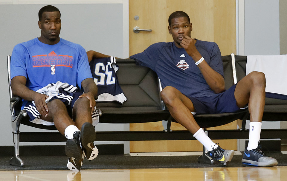 Photo - Kendrick Perkins and Kevin Durant sit in chairs after their team practice during the Oklahoma City Thunder media availability at the Thunder practice facility in Oklahoma City, Okla. on Monday, May 12, 2014.   Photo by Chris Landsberger, The Oklahoman