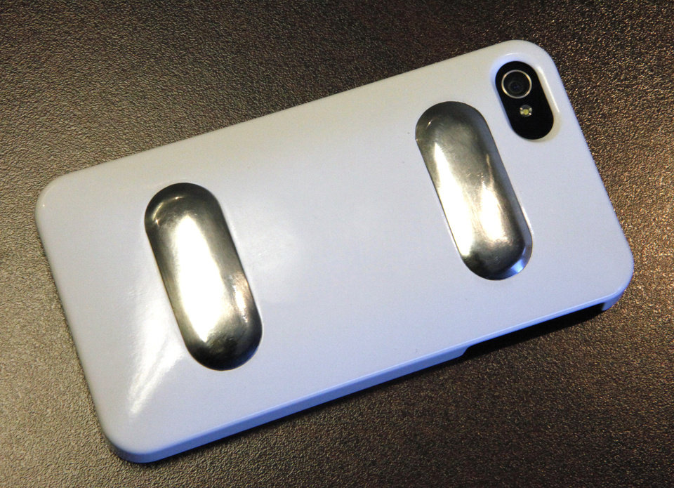 Metal sensors on the back of the cover allow the iPhone to work as a heart monitor. Photo by David McDaniel, The Oklahoman