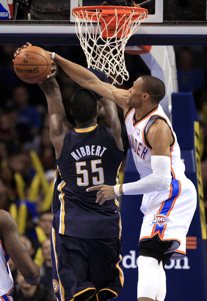 Photo - Oklahoma City's Russell Westbrook (0) blocks the shot of Indiana's Roy Hibbert (55) during the NBA game between the Indiana Pacers and the Oklahoma City Thunder at the Chesapeake Energy Arena   Sunday,Dec. 9, 2012. Photo by Sarah Phipps, The Oklahoman