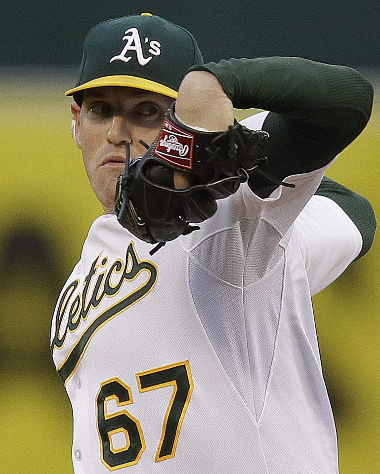 Photo - Oakland Athletics' Dan Straily works against the Texas Rangers in the first inning of a baseball game Monday, April 21, 2014, in Oakland, Calif. (AP Photo/Ben Margot)