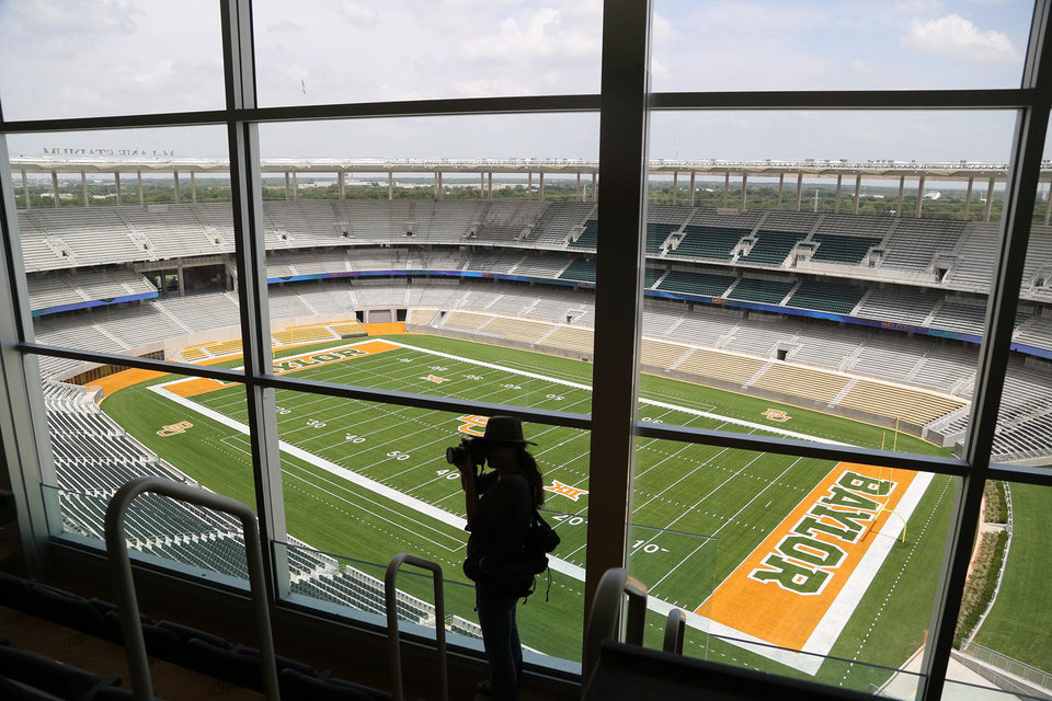 Photo - FILE - In this Aug. 18, 2014 file photo, media and visitors tour the nearly completed McLane Stadium during a tour at Baylor University in Waco, Texas. The $260 million stadium located near campus on the Brazos river debuts at the end of the month  and replaces the  64-year-old Floyd Casey Stadium. (AP Photo/Waco Tribune Herald, Rod Aydelotte, File)