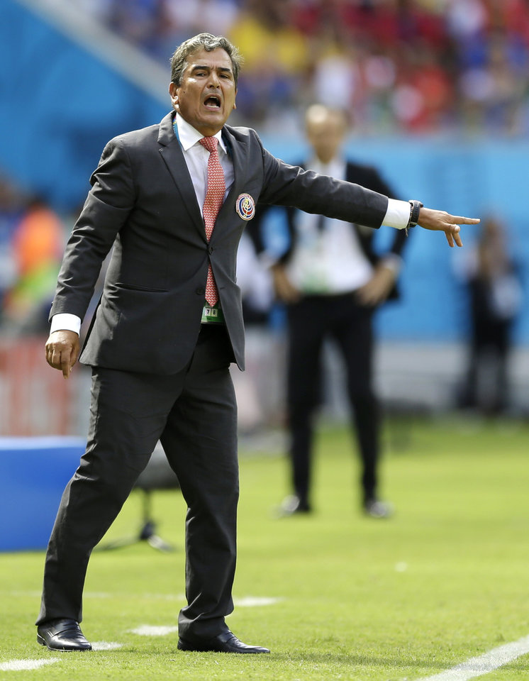 Photo - Costa Rica's head coach Jorge Luis Pinto gives directions to his players during the group D World Cup soccer match between Italy and Costa Rica at the Arena Pernambuco in Recife, Brazil, Friday, June 20, 2014.  (AP Photo/Ricardo Mazalan)
