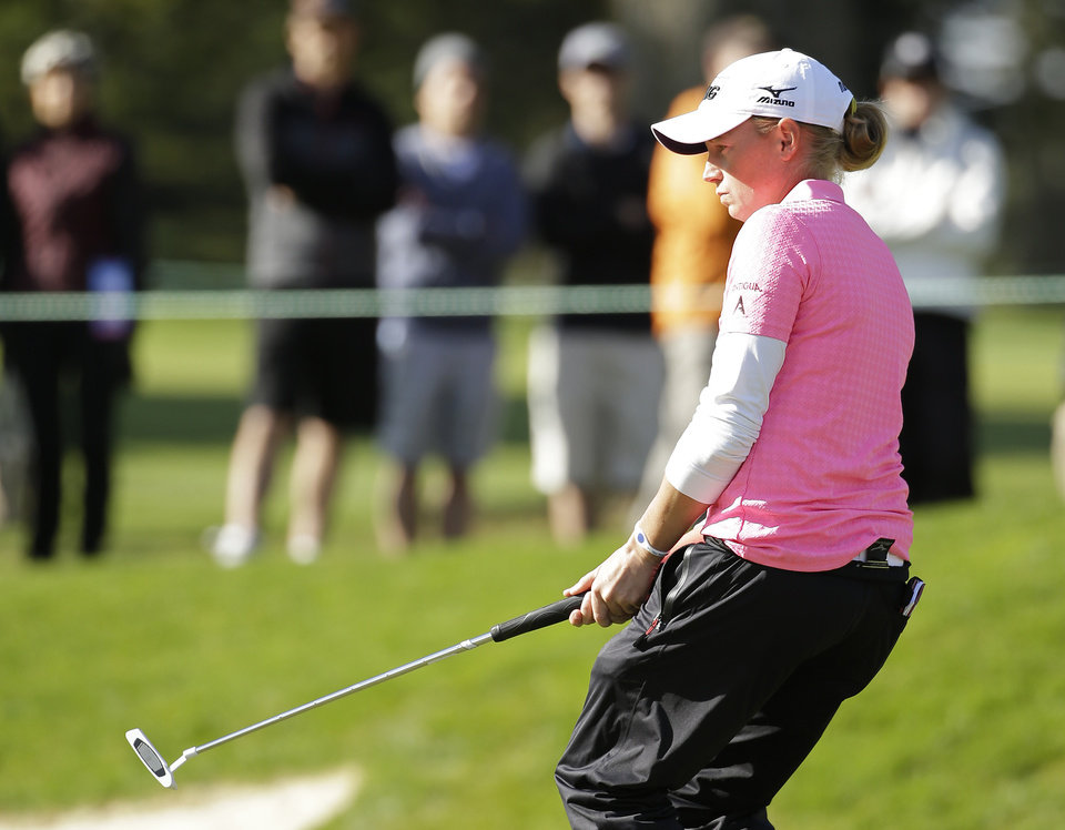 Photo - Stacy Lewis reacts after missing a birdie putt on the 14th green of the Lake Merced Golf Club during the third round of the Swinging Skirts LPGA Classic golf tournament on Saturday, April 26, 2014, in Daly City, Calif. (AP Photo/Eric Risberg)
