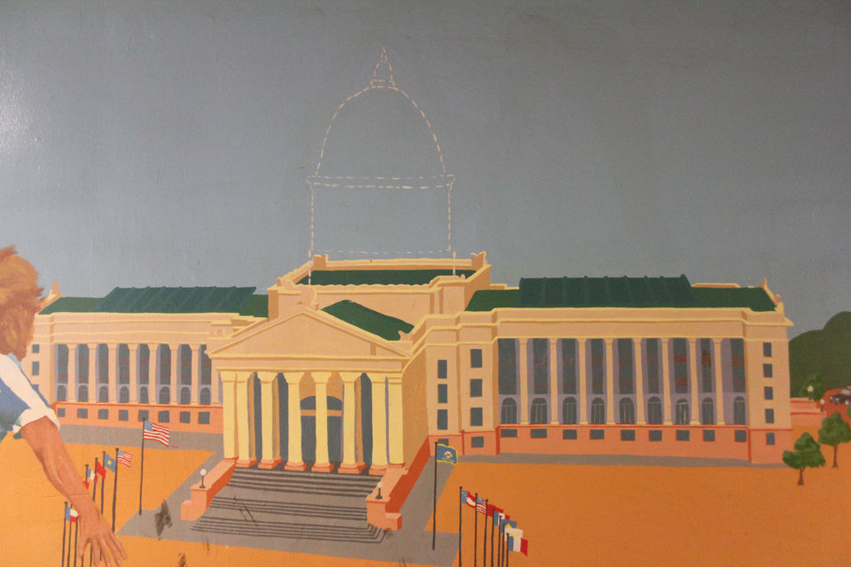 Photo - Murals on both sides of the tunnel were painted in 1991, before the dome was added in 2002 to the state Capitol. Someone since sketched in the dome.  BY MICHAEL MCNUTT - THE OKLAHOMAN