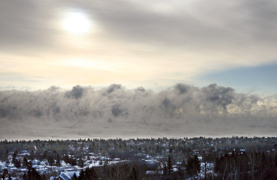 Photo - Fog forms over Lake Superior on Monday, Jan. 21, 2013, along the Duluth, Mich. shoreline as the area experiences subzero temperatures. (AP Photo/The Duluth News-Tribune, Bob King)