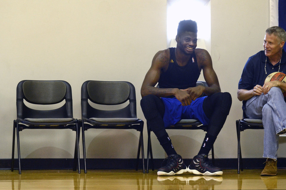 Philadelphia 76ers returning player Nerlens Noel talks with coach Brett Brown, right, during practice, Wednesday July 2, 2014 in Philadelphia. (AP Photo/The Philadelphia Inquirer, Tom Gralish)