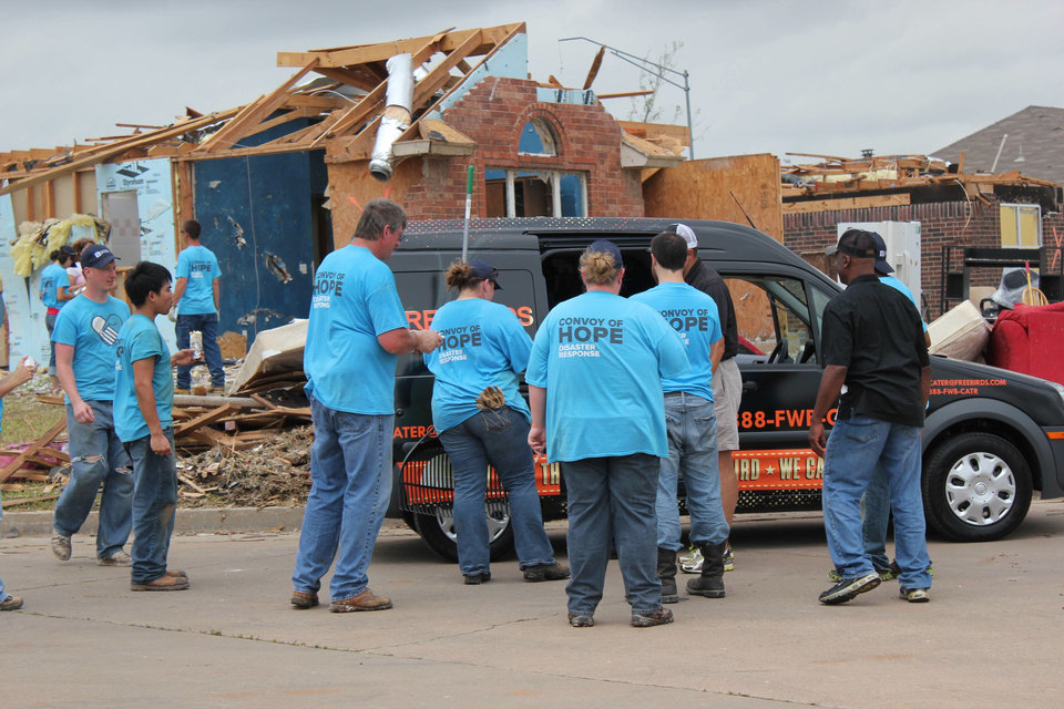 Photo - Volunteers from FreeBird World Burrito brought food to workers in the storm damaged neighborhoods of Moore. Photo provided   - PROVIDED