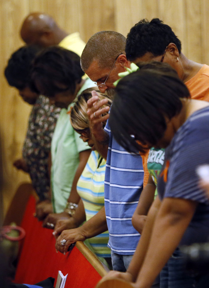 Photo - People pray during a rally in support of Darrell Williams at Mt. Zion Baptist Church in Stillwater, Okla., Thursday, Aug. 23, 2012. Williams, a suspended Oklahoma State basketball player, was found guilty on two counts of rape by instrumentation and one count of sexual battery after an incident at a house party. Photo by Nate Billings, The Oklahoman