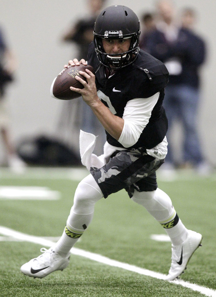 Photo - Texas A&M quarterback Johnny Manziel passes the ball during a drill at pro day for NFL football representativesin College Station, Texas, Thursday, March 27, 2014. (AP Photo/Patric Schneider)