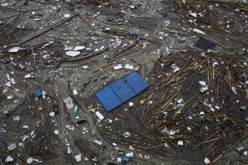 Photo - Trash collects along the shore after after a rainstorm in Long Beach, Calif. on Saturday, March 1, 2014. (AP Photo/Ringo H.W. Chiu)