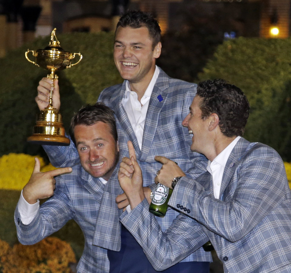 Photo - Europe's Martin Kaymer, Graeme McDowell and Justin Rose have some fun after winning the Ryder Cup PGA golf tournament Sunday, Sept. 30, 2012, at the Medinah Country Club in Medinah, Ill. (AP Photo/Chris Carlson)  ORG XMIT: PGA289