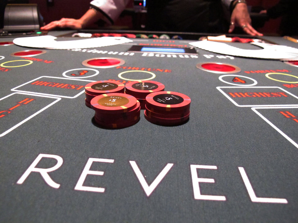 Photo - In this March 28, 2012 photo, gambling chips sit on a card table at Revel Casino Hotel as a dealer prepares for the casino's opening a few days later, in Atlantic City, N.J. New Jersey will begin Internet gambling on Nov. 26, 2013, after a five-day trial period to make sure the system is working correctly. (AP Photo/Wayne Parry)