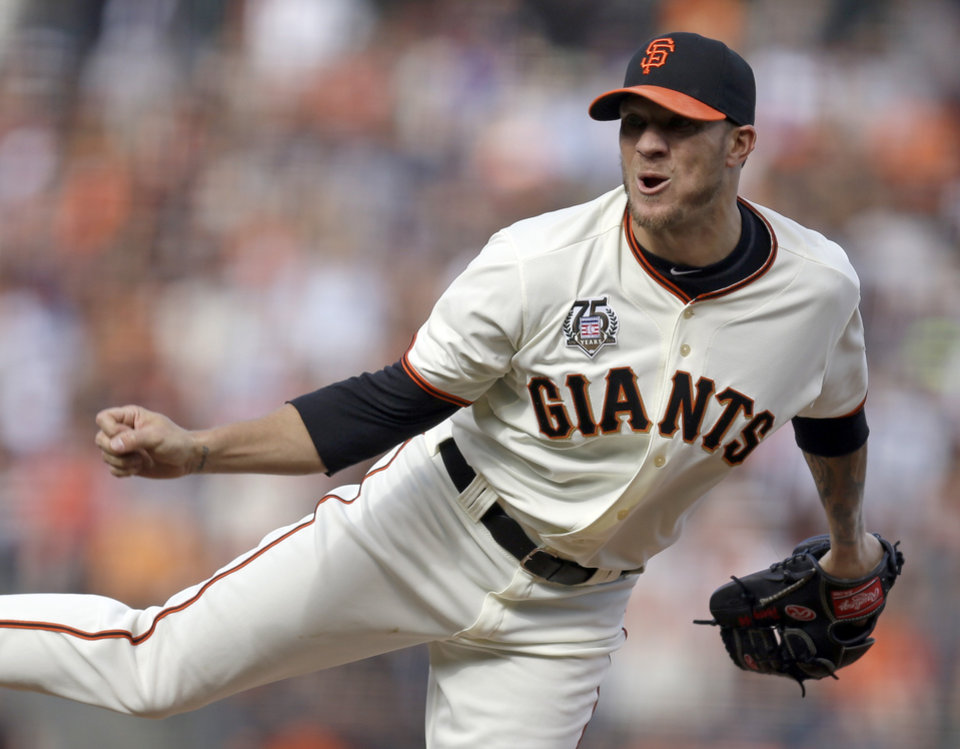 Photo - San Francisco Giants' Jake Peavy works against the Los Angeles Dodgers in the first inning of a baseball game Sunday, July 27, 2014, in San Francisco. (AP Photo/Ben Margo)