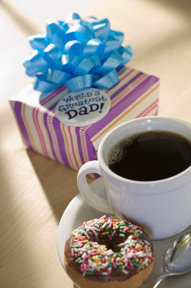 Photo - Surprise dad on Father's Day morning with fresh coffee, breakfast and a Father's Day gift. Thinkstock photo.  Jupiterimages