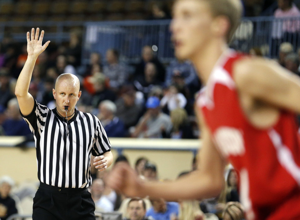 Chris Cooksey officiates during the Class B Boys semi-final game of the state high school basketball tournament between Big Pasture and Arnett at the State Fair Arena., Friday, March 1, 2013. Photo by Sarah Phipps, The Oklahoman