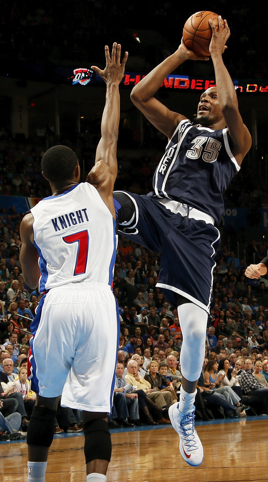 Photo - Oklahoma City's Kevin Durant (35) shoots over Detroit's Brandon Knight (7) during an NBA basketball game between the Detroit Pistons and the Oklahoma City Thunder at the Chesapeake Energy Arena in Oklahoma City, Friday, Nov. 9, 2012. Photo by Nate Billings, The Oklahoman