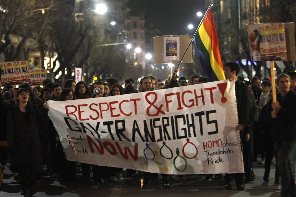 Photo - Several hundred gay rights activists march during a protest in the northern Greek port city of Thessaloniki, Greece, Friday, Feb. 7, 2014. The protest was against Russia's anti-gay laws on the same day as the opening ceremony of the Olympic Games in Sochi  (AP Photo/Nikolas Giakoumidis)