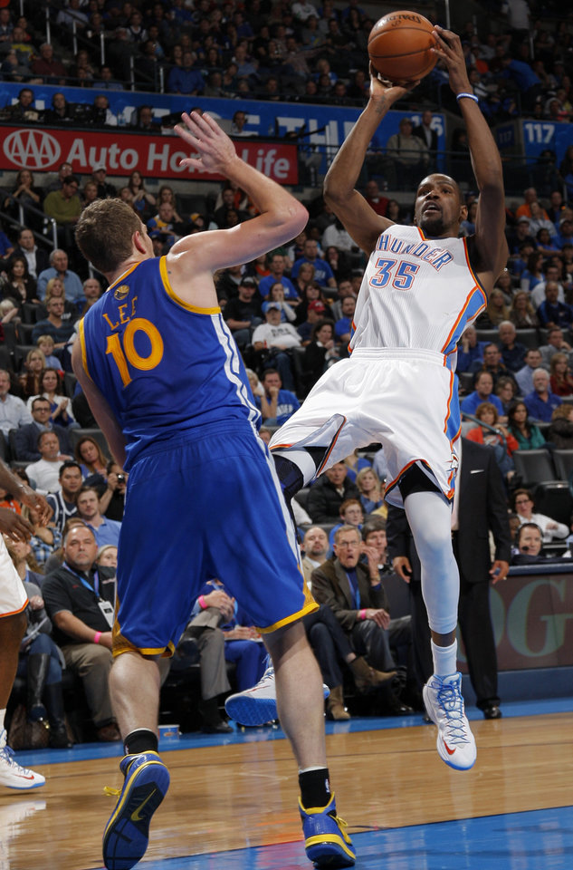 Oklahoma City 's Kevin Durant (35) takes a shot over Golden State's David Lee (10) during an NBA basketball game between the Oklahoma City Thunder and the Golden State Warriors at Chesapeake Energy Arena in Oklahoma City, Sunday, Nov. 18, 2012.  Photo by Garett Fisbeck, The Oklahoman