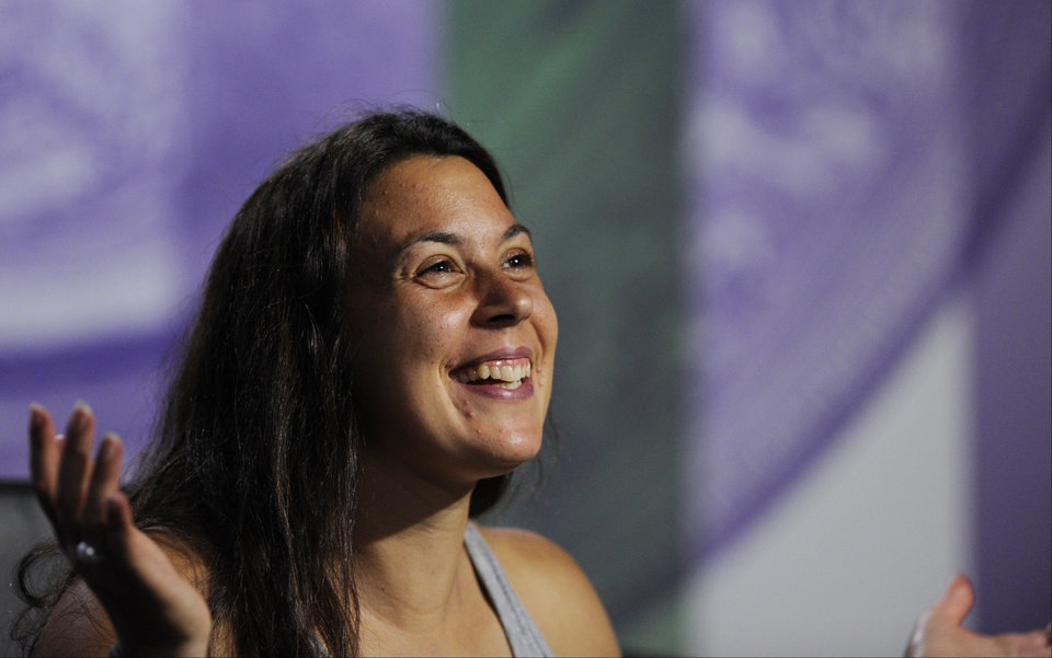 Photo - Marion Bartoli of France speaks at a news conference after winning the Women's singles final match against Sabine Lisicki of Germany at the All England Lawn Tennis Championships, Wimbledon, London, Saturday, July 6, 2013. (AP Photo/AELTC, Tom Lovelock)