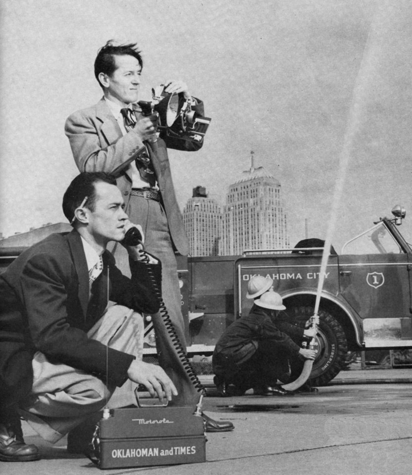 Photo - Oklahoma Publishing Co. staff photographer Thomas Killian (standing) and OPUBCO reporter Deacon New (kneeling) demonstrate the Oklahoman and Times editorial department's  new portable walkie-talkie radio unit first used in 1951. Photo scanned from the cover of the November-December, 1951 Cuff Stuff magazine.