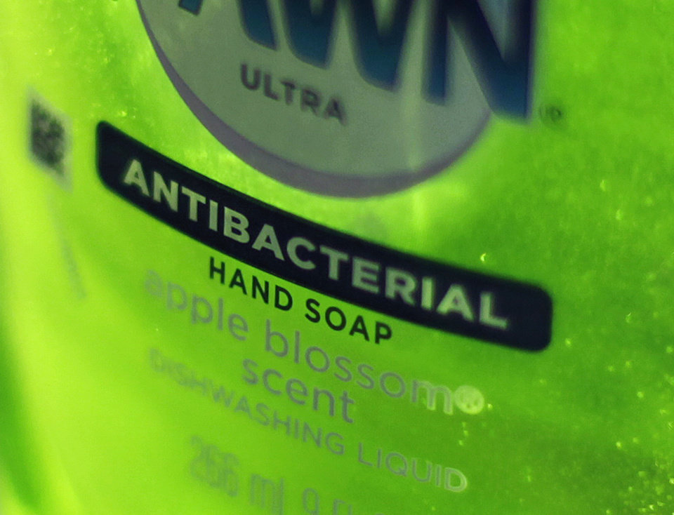 Photo - This Tuesday, April 30, 2013, photo, shows Dawn Ultra antibacterial soap in a kitchen Tuesday in Chicago. Federal health regulators are deciding whether triclosan, the germ-killing ingredient found in an estimated 75 percent of anti-bacterial liquid soaps and body washes sold in the U.S. is harmful. The ruling, which will determine whether triclosan continues to be used in household cleaners, could have broader implications for a $1 billion industry that includes hundreds of anti-bacterial products from toothpaste to toys (AP Photo/Kiichiro Sato)