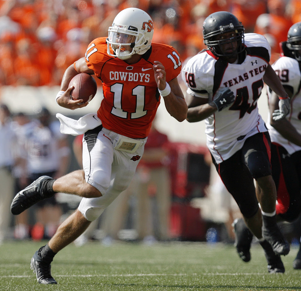 Oklahoma State quarterback Zac Robinson (11) out runs Texas Tech\'s Paul Williams (48) on his way to a touchdown during the first half of the college football game between the Oklahoma State University Cowboys (OSU) and the Texas Tech University Red Raiders (TTU) at Boone Pickens Stadium in Stilllwater, Okla., on Saturday, Sept. 22, 2007. By NATE BILLINGS, The Oklahoman