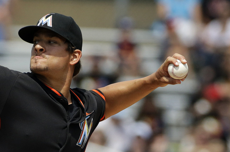 Photo - Miami Marlins starting pitcher Brad Hand throws in the first inning of an exhibition spring training baseball game against the New York Mets, Saturday, March 22, 2014, in Jupiter, Fla. (AP Photo/David Goldman)