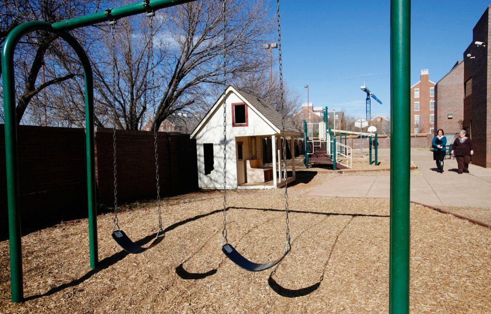 Swings are empty on a weekday morning at a state shelter for children in Oklahoma City.