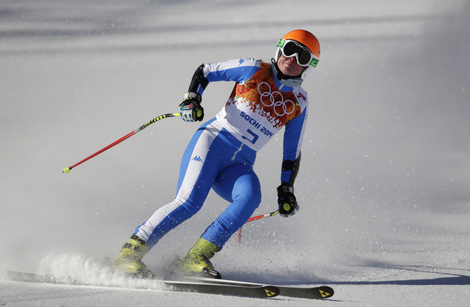 Photo - Italy's Verena Stuffer comes to a halt in the finish area after completing a women's downhill training run at the Sochi 2014 Winter Olympics, Thursday, Feb. 6, 2014, in Krasnaya Polyana, Russia. (AP Photo/Gero Breloer)