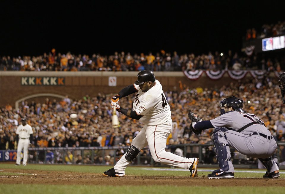Photo -   San Francisco Giants' Pablo Sandoval hits a single during the seventh inning of Game 1 of baseball's World Series against the Detroit Tigers Wednesday, Oct. 24, 2012, in San Francisco. Alex Avila is catching for the Tigers. (AP Photo/Marcio Jose Sanchez)