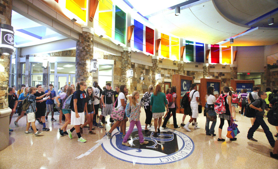 Students enter the new Deer Creek Middle School on Tuesday.  Photos by Paul B. Southerland, The Oklahoman