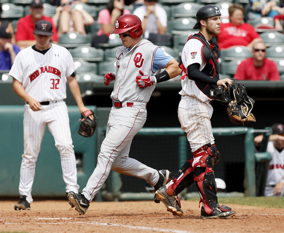 OU's Max White (7) scores in the 8th inning past Texas Tech catcher Mason Randolph (18) as Justin Bethard (32) looks on during an NCAA baseball game between Oklahoma and Texas Tech in the Big 12 Baseball Championship tournament at the Chickasaw Bricktown Ballpark in Oklahoma City, Friday, May 24, 2013. OU won 8-0. Photo by Nate Billings, The Oklahoman