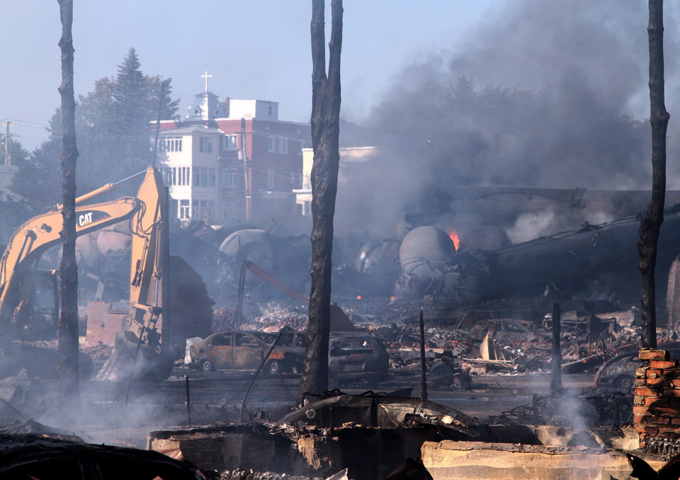 Photo - In a Monday, July 8, 2013 photo provided by Surete du Quebec via The Canadian Press, the downtown core lies in ruins in Lac-Megantic, Quebec, in a Surete du Quebec. Thirteen people are confirmed dead and forty more are listed as missing after a train derailed ignited tanker cars carrying crude oil.  (AP Photo/Surete du Quebec via The Canadian Press)