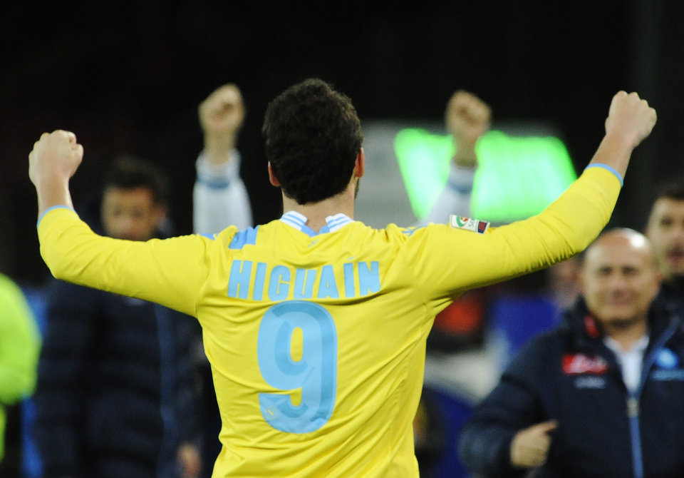 Photo - Napoli's Gonzalo Higuaín celebrates after scoring during a Serie A soccer match between Napoli and Milan, at the San Paolo stadium in Naples, Italy, Saturday, Feb. 8, 2014. (AP Photo/Salvatore Laporta)