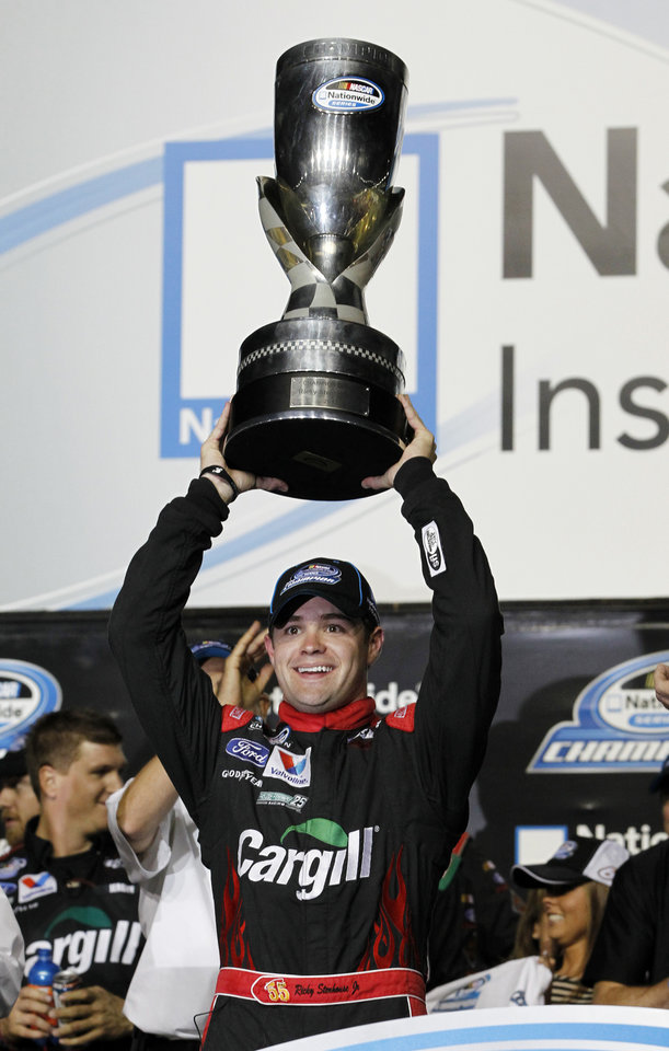 Driver Ricky Stenhouse Jr. raises the NASCAR Nationwide Series Championship trophy at Homestead-Miami Speedway, Saturday, Nov. 17, 2012 in Homestead, Fla. Stenhouse finished sixth Saturday in the season finale at Homestead-Miami Speedway, edging Elliott Sadler for the title. (AP Photo/Terry Renna)