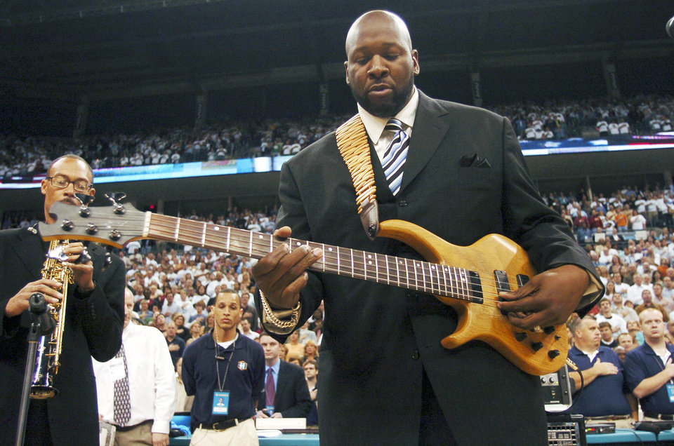 Photo - NBA BASKETBALL: Wayman Tisdale, former OU basketball player and former NBA player, performs the National Anthem, during the New Orleans/Oklahoma City Hornets season opening game against the Sacramento Kings, Tuesday, November 1,  2005, at the Ford Center, in Oklahoma City.  by Bill Waugh/The Oklahoman.