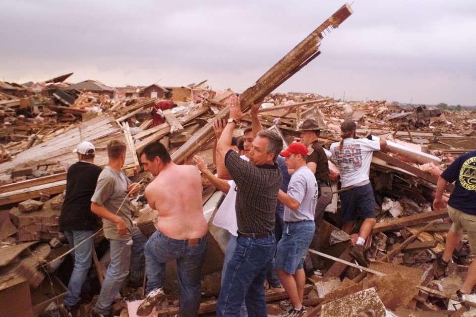 May 3, 1999, Oklahoma City Tornado:  Tornado damage, victim: Volunteer rescue workers remove the rubble of Renee Faulkinberry's home in the Country Place Estates housing addition SW of 134th and S. Penn to reach the woman. About a dozen volunteers worked for nearly a half hour to free Renee.  Photo by Paul Hellstern