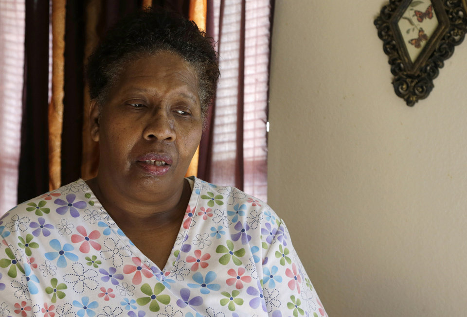ADVANCE FOR TUESDAY, JAN. 29 AND THEREAFTER - This photo taken Jan. 18, 2013 shows part-time home health care provider Debra Walker in her home in Houston. President Barack Obama thinks his health care law makes states an offer they can't refuse. Whether to expand Medicaid _the federal-state program for the poor and disabled_ could be the most important decision facing governors and legislatures this year. The repercussions go beyond their budgets, directly affecting the well-being of residents and the finances of critical hospitals. Awaiting decisions are people like Walker, a part-time home health care provider. She had a good job with health insurance until she got laid off in 2007.  (AP Photo/Pat Sullivan)