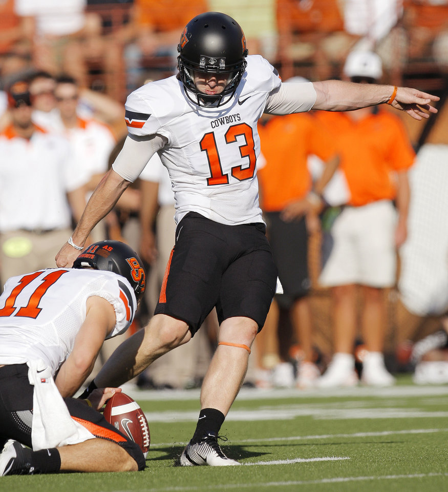 Photo - Oklahoma State's Quinn Sharp (13) kicks a field goal as Wes Harlan (11) holds the ball in the third quarter during a college football game between the Oklahoma State University Cowboys (OSU) and the University of Texas Longhorns (UT) at Darrell K Royal-Texas Memorial Stadium in Austin, Texas, Saturday, Oct. 15, 2011. OSU won, 38-26. Photo by Nate Billings, The Oklahoman