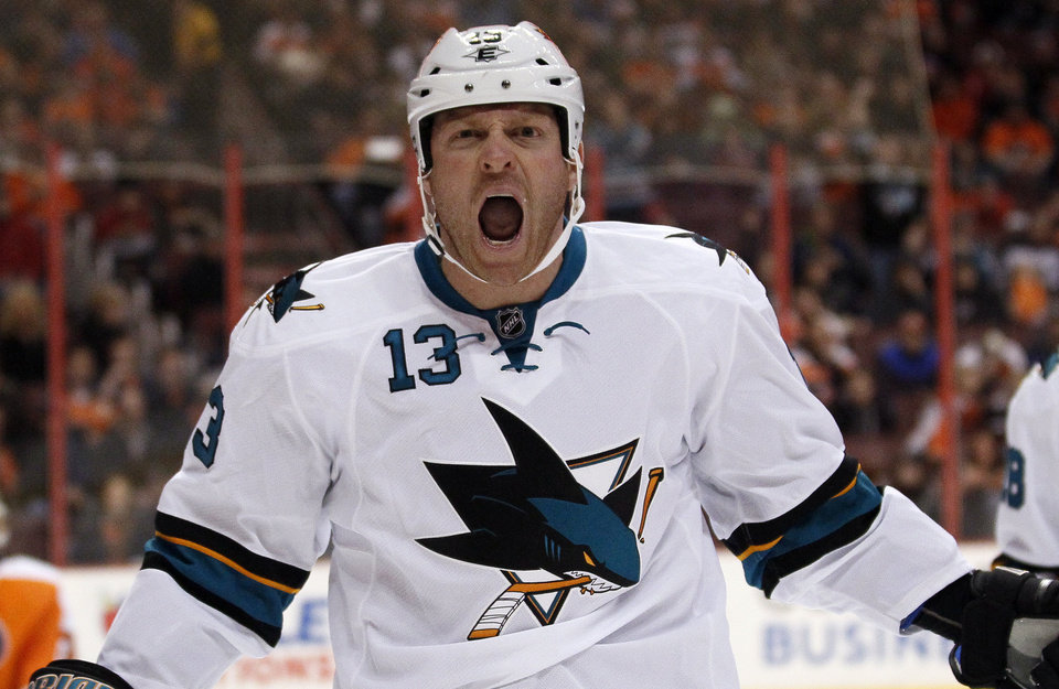 Photo - San Jose Sharks' Raffi Torres shouts after scoring during the first period of an NHL hockey game against the Philadelphia Flyers, Thursday, Feb. 27, 2014, in Philadelphia. (AP Photo/Tom Mihalek)