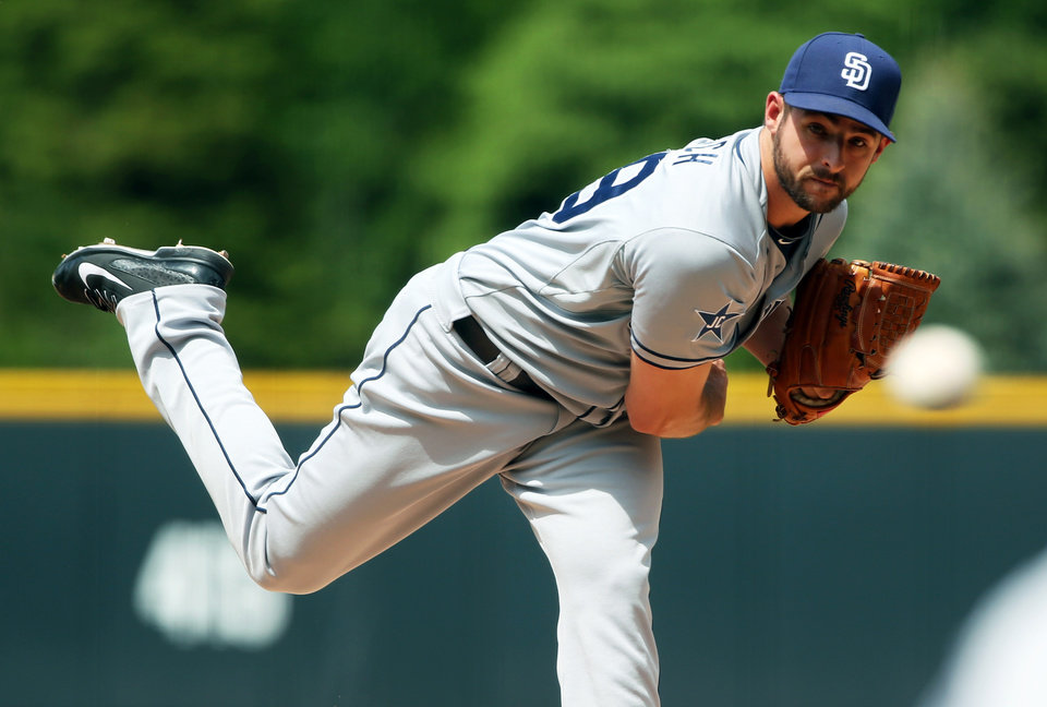 Photo - San Diego Padres starting pitcher Donn Roach, making the first start in his career, works against the Colorado Rockies in the first inning of a baseball game in Denver on Sunday, May 18, 2014. (AP Photo/David Zalubowski)