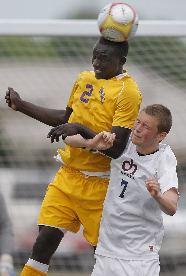 Northwest Classen's Habiel Ismael and Cascia Hall's George Howard fight for a ball during the boys 5A soccer state championship game between Northwest Classen and Cascia Hall at Edmond North High School in Edmond, Okla., Saturday, May 12, 2012. Photo by Sarah Phipps, The Oklahoman
