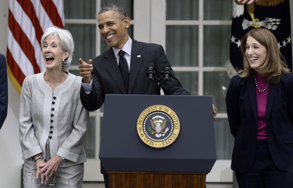 Photo - President Barack Obama, flanked by outgoing Health and Human Services Secretary Kathleen Sebelius, left, and his nominee to replace Sebelius, current Budget director Sylvia Mathews Burwell, right,  shares a laugh in the Rose Garden of the White House in Washington, Friday, April 11, 2014, where he made the announcement. (AP Photo/Susan Walsh)