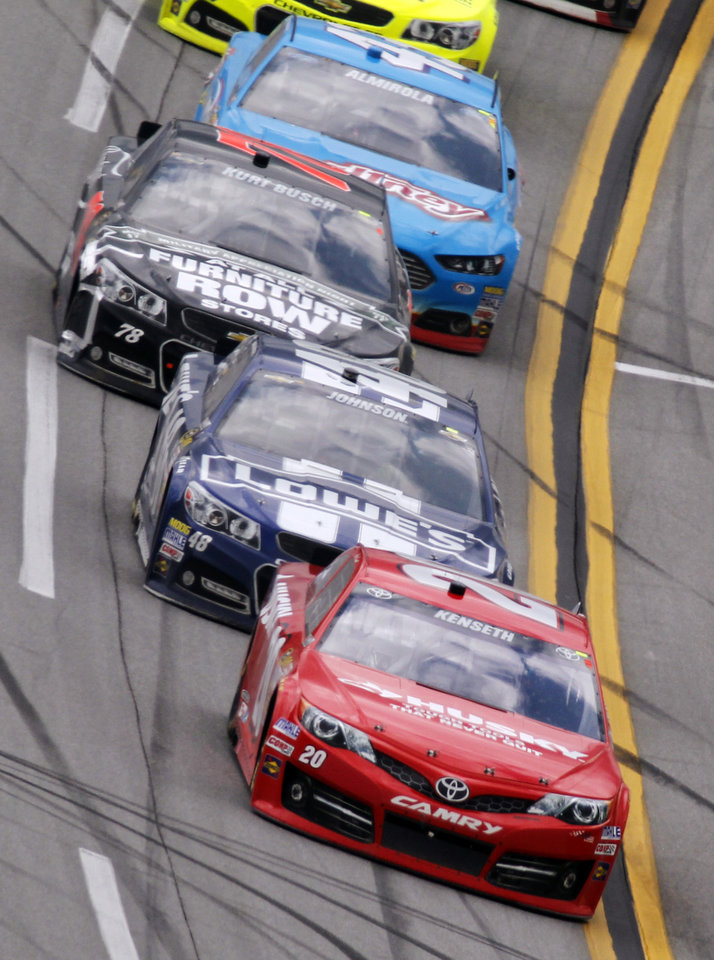 Photo - Matt Kenseth leads a pack of cars during the NASCAR Sprint Cup Series Aaron's 499 auto race at Talladega Superspeedway in Talladega, Ala., Sunday, May 5, 2013. (AP Photo/Butch Dill)