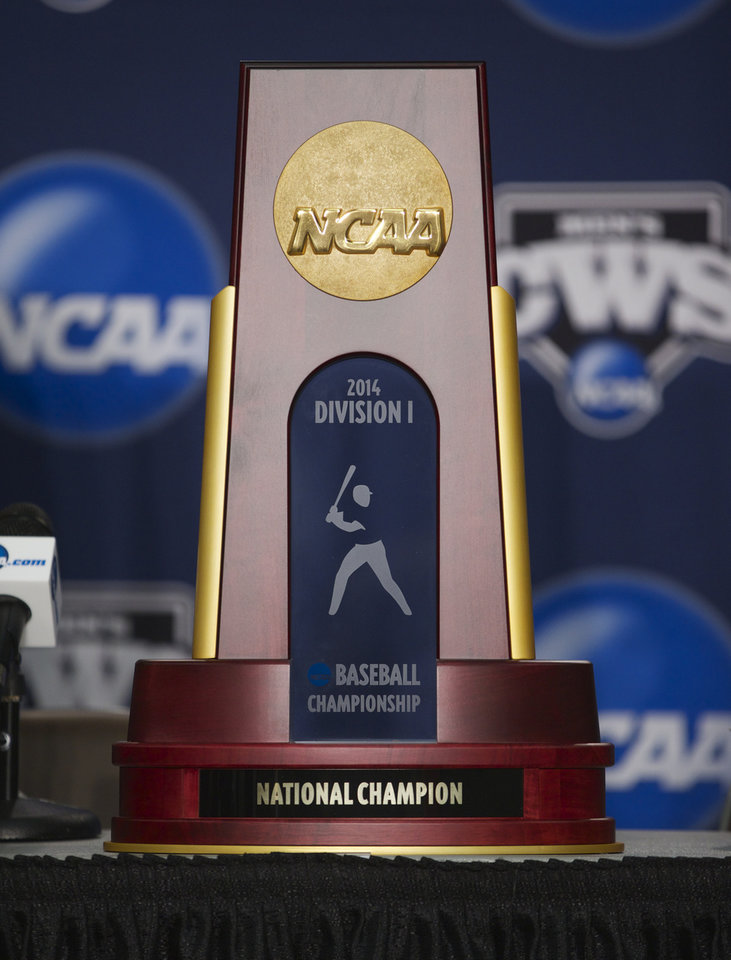 Photo - The College World Series trophy is displayed during a news conference on Sunday, June 22, 2014, ahead of the NCAA baseball College World Series finals between Virginia and Vanderbilt which begin on Monday at TD Ameritrade Park in Omaha, Neb. (AP Photo/Nati Harnik)