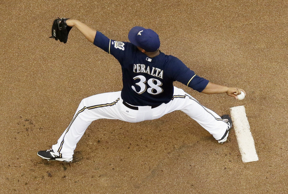 Photo - Milwaukee Brewers starting pitcher Wily Peralta throws during the first inning of a baseball game against the Pittsburgh Pirates on Saturday, Aug. 23, 2014, in Milwaukee. (AP Photo/Morry Gash)