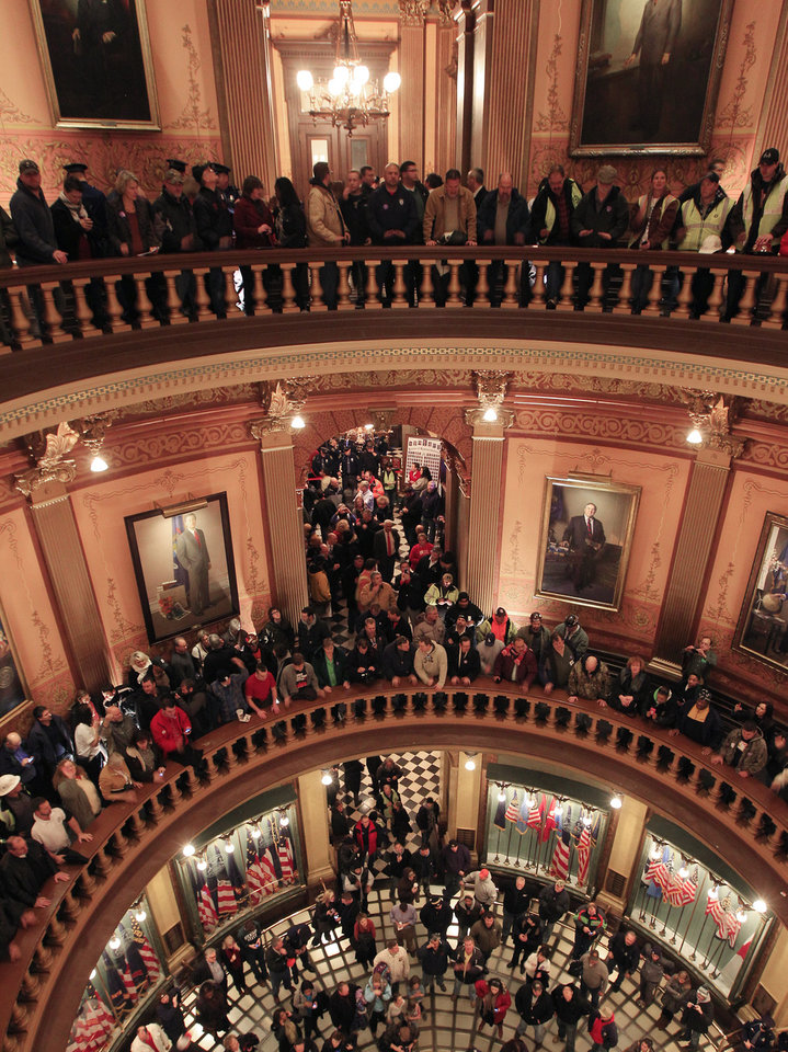 Union workers fill the entire of the Capitol rotunda in Lansing, Mich., Thursday, Dec. 6, 2012. Hundreds of chanting and cheering protesters streamed back into the Michigan Capitol after receiving a court order saying that the building must reopen. The pro-union crowd walked in as lawmakers were debating right-to-work legislation limiting union powers. The Republican-led House subsequently passed the bill with no Democratic support. (AP Photo/Carlos Osorio)