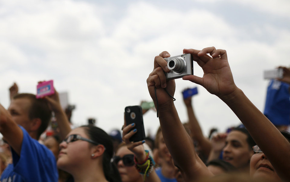Photo - Fans take pictures during a welcome home rally for the Oklahoma City Thunder at a field near Will Rogers Airport in Oklahoma City, Friday, June 22, 2012.  Photo by Garett Fisbeck, The Oklahoman