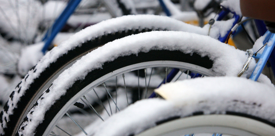Photo - Snow covered bicycle tires in the racks on the University of Central Oklahoma campus in Edmond Monday, Feb. 13, 2012. Because of the weather Monday UCO was closed and classes delayed until 10am. Photo by Paul B. Southerland, The Oklahoman